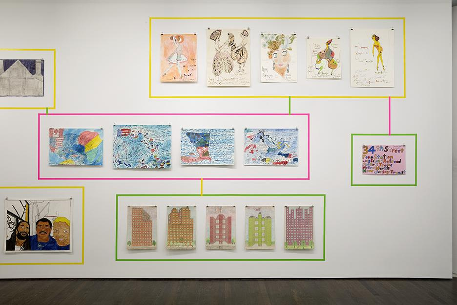 Works by Lady Shalimar Montague, Adeyinka Perry and Rocco Fama installed on a white wall in groups by artist, each group bordered by a colored rectangular outline.
