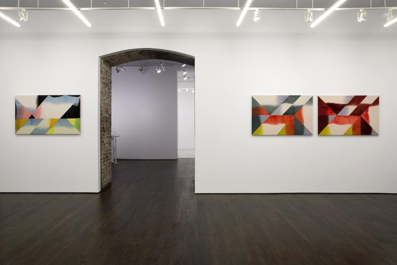 Wilder Alison, installation view, 2019-2020 (Three similarly sized rectangular paintings installed at the same height on a wall around a brick arched entryway: one to the left and two to the right. The work to the left, sweep/s light bristles/Granulerer is made of dyed wool that has been cut up and sewn together, resulting in patches of light blue, black, pink, orange, yellow and a bit of green. The two works to the left, fuse the /fuse—s/lip greenery, horse and horse a/ flame/IN/flame are made in the same way and are installed very close to each other and have the same composition with slight variations in color - where the work to the left has dark green patches the right work has patches of deep brown.)
